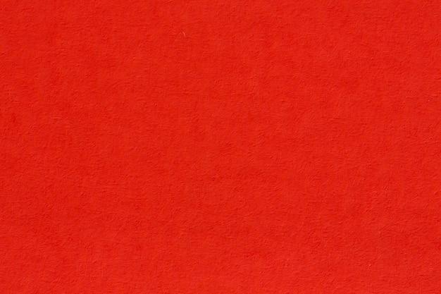 Fond texturé en papier kraft recyclé de couleur rouge clair vieux rose. photo haute résolution.