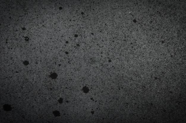Fond de texture de papier noir avec des éraflures, des rayures, des taches.