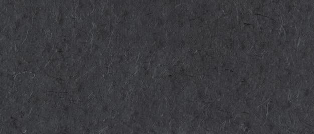 Fond de texture de papier noir recyclé népalais naturel. bannière horizontale