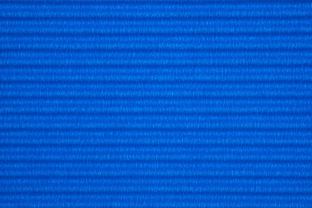 Fond de texture de papier ondulé bleu