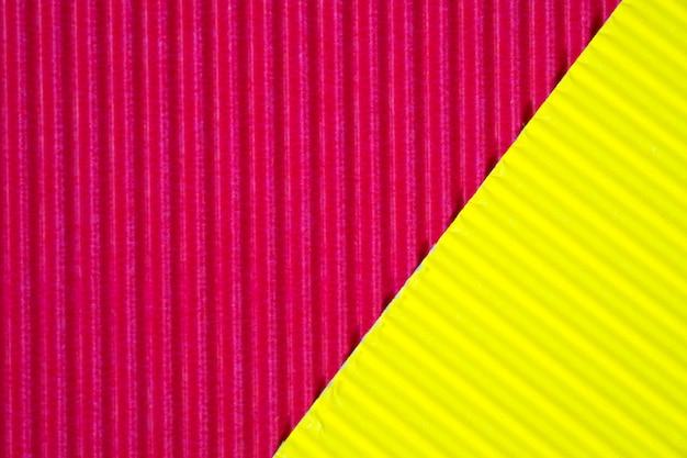 Fond de texture de papier ondulé rouge et jaune.