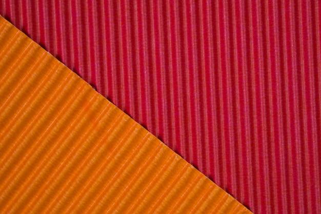 Fond de texture de papier ondulé rouge et orange