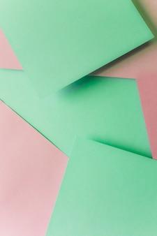 Fond de texture de papier pastel vert et rose