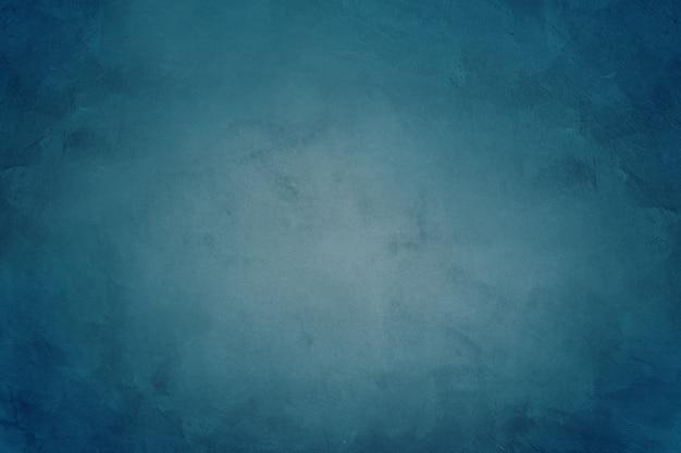 Fond de texture de papier peint ciment bleu foncé