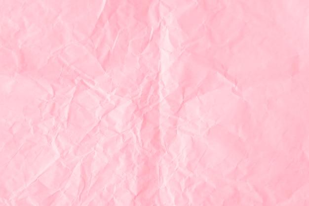 Fond texturé de papier rose flamant froissé