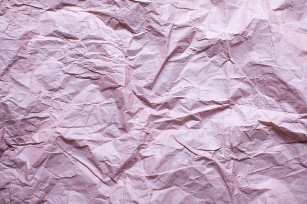 Fond de texture de papier rose froissé