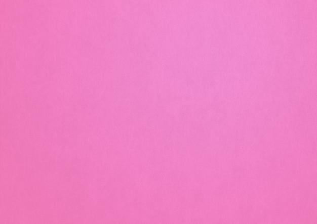 Fond de texture de papier rose pâle.