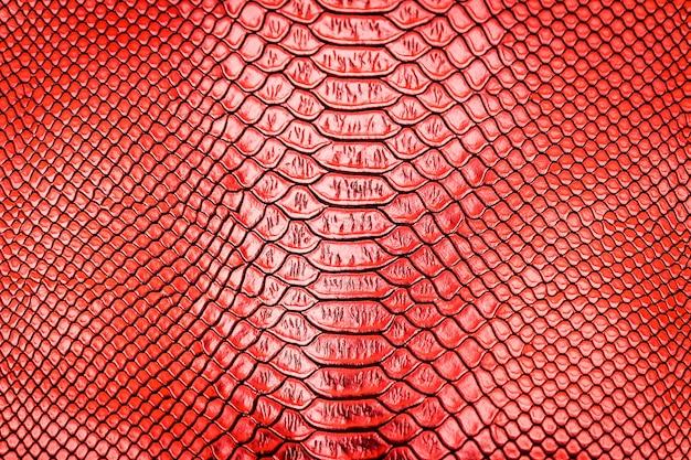 Fond de texture de peau de serpent rouge