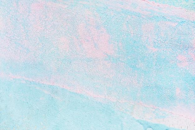 Fond texturé de peinture bleu et rose