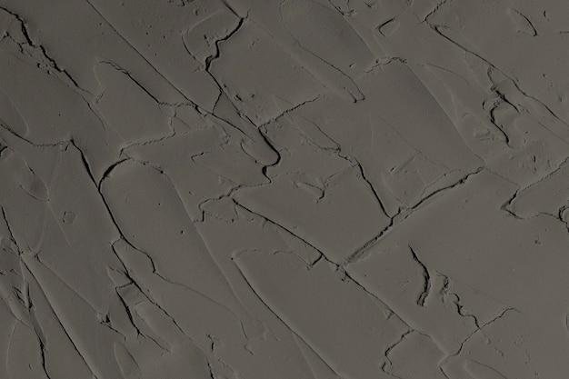 Fond texturé de peinture murale gris foncé