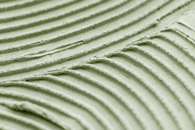 Fond texturé de peinture murale verte