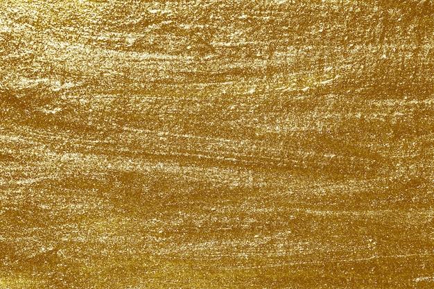 Fond texturé de peinture or métallique