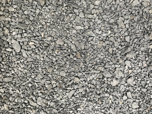 Fond de texture de petites pierres de gravier gris