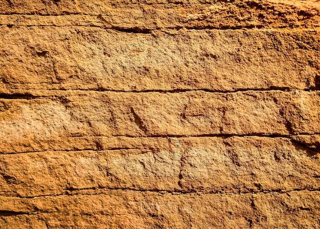 Fond texturé en pierre brune