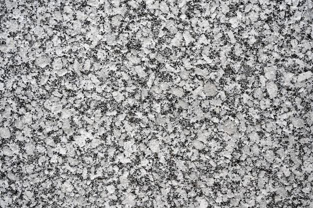 Fond de texture de pierre de granit gris blanc