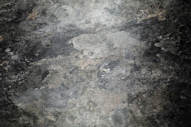 Fond de texture de pierre de granit patiné rugueux.
