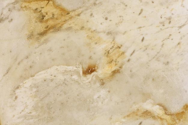 Fond de texture de pierre en marbre jaune.