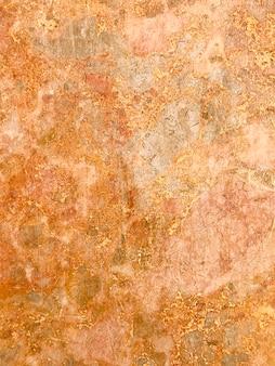 Fond, texture de pierre naturelle de teinte rose.