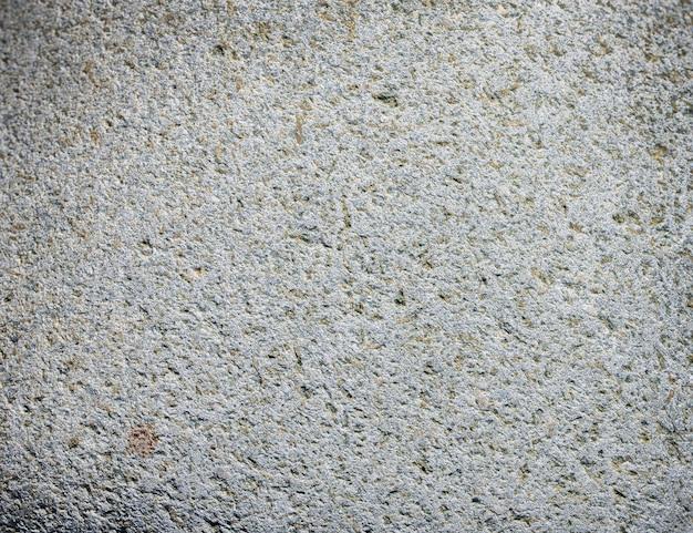 Le fond ou la texture de la pierre noire gris foncé.