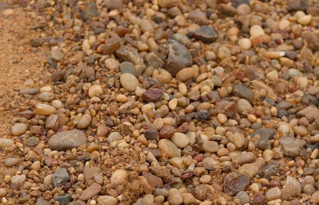 Fond texturé de pierres et de sable de la rivière