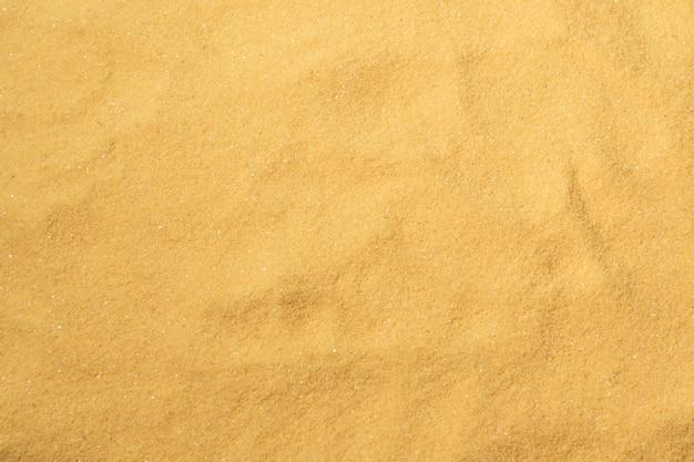 Fond et texture de plage de sable.