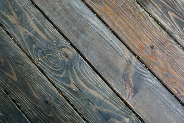 Fond de texture de plancher en bois rustique de couleurs naturelles, rayures diagonales