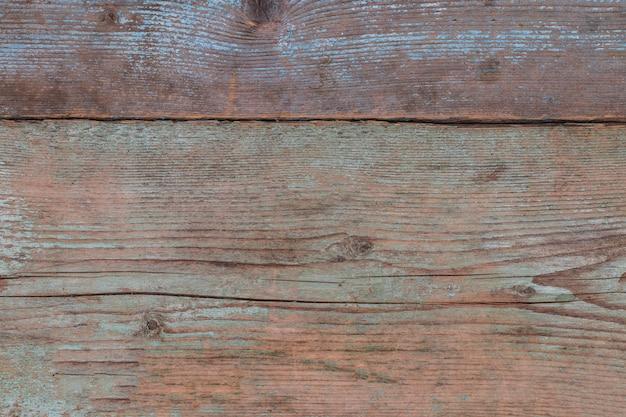 Fond de texture de planches de bois bleu pastel patiné.