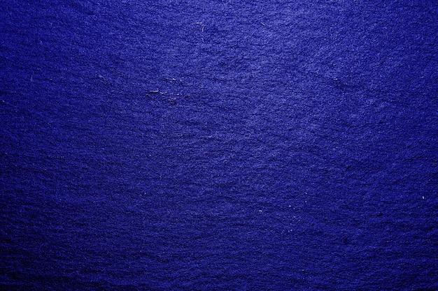 Fond de texture de plateau en ardoise bleue. texture de roche d'ardoise noire naturelle