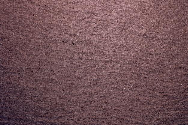Fond de texture de plateau en ardoise rose. texture de roche d'ardoise noire naturelle