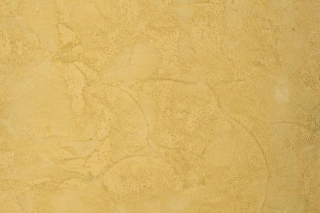 Fond de la texture plâtrée avec une couleur or effet marbre. fond artistique fait main