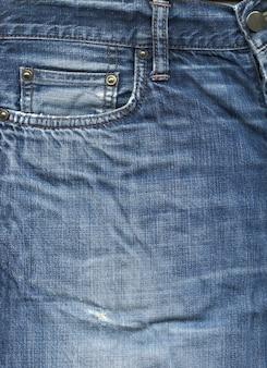 Fond de texture de poche de pantalon en denim bleu
