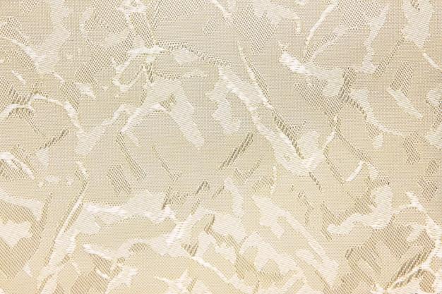 Le fond de texture de rideau aveugle en tissu beige peut être utilisé pour la toile de fond ou la couverture