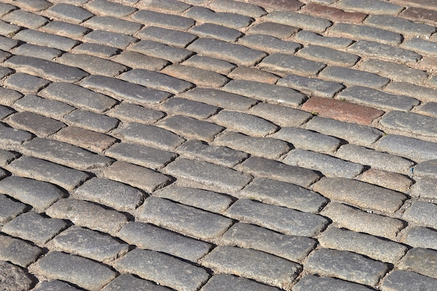 Fond de texture de route de chaussée en pierre vintage gris