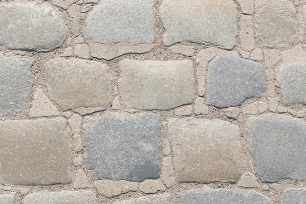 Fond de texture de route pavée de granit