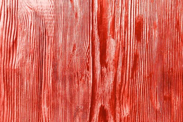 Fond de texture rugueuse de couleur corail en bois