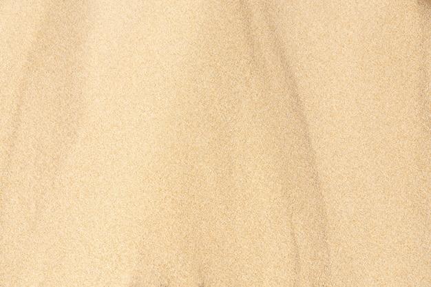 Fond de texture de sable. modèle de désert brun de plage tropicale. fermer.