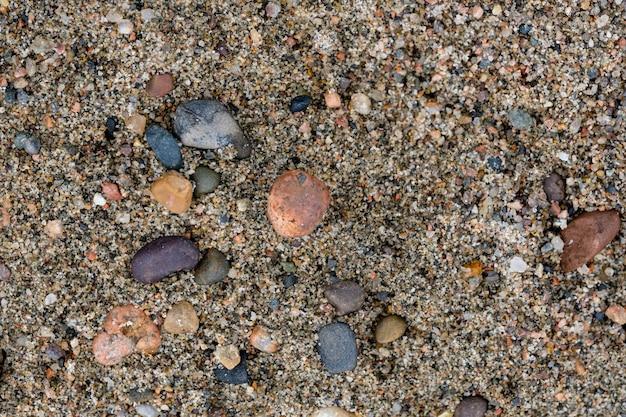 Fond de texture de sable et de roches. abstrait