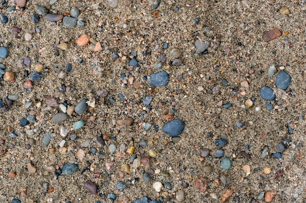 Fond de texture de sable et de roches. tons naturels beiges