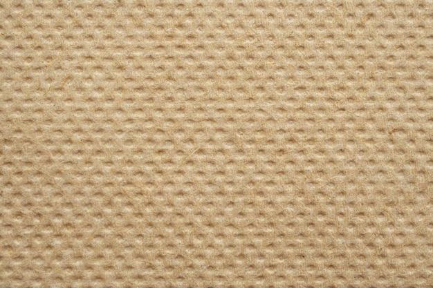 Fond de texture de serviette en papier de soie recyclé abstrait brun