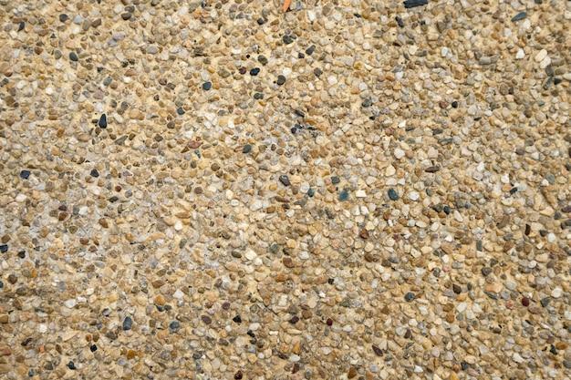 Fond de texture de sol de galets bruns