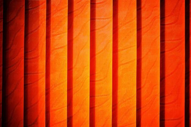 Fond de texture de stores fermés orange verticaux hd