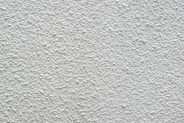 Fond de texture en stuc blanc d'un mur en pierre sèche