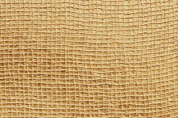 Fond texturé de surface dorée brillante