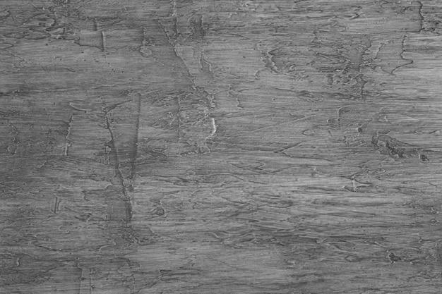 Fond avec texture de surface rustique avec une couleur noire vieillie.
