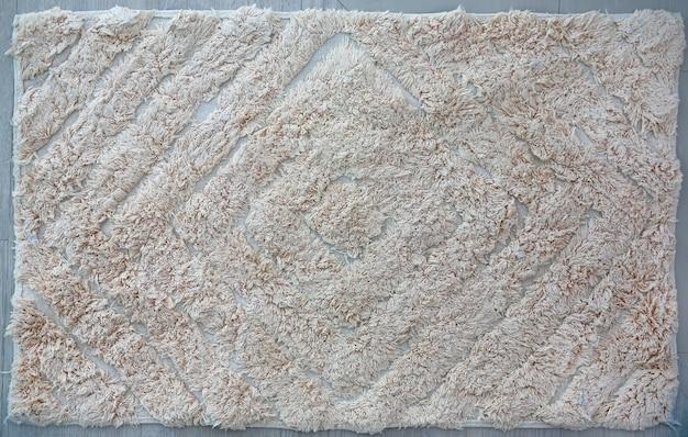 Un fond de texture de tapis gris.