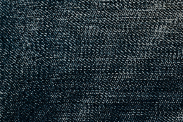 Fond texturé de tapis en tissu bleu