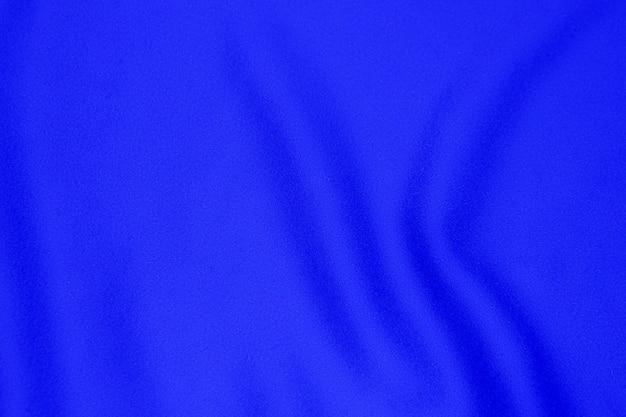 Fond de texture de tissu bleu, couleur bleu doux de tissu ondulé, texture de tissu de satin ou de soie de luxe.