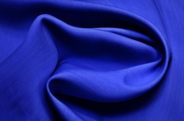 Fond de texture de tissu bleu