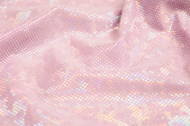 Fond texturé en tissu brillant rose.