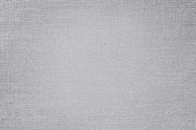 Fond texturé en tissu de coton argenté
